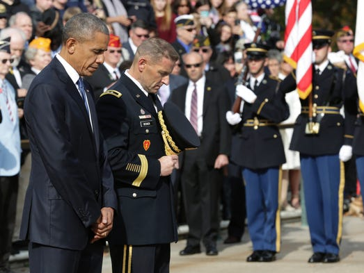 Obama participates in a wreath-laying ceremony at the