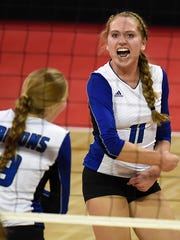 Green Bay Notre Dame's Corinne Meglic (11) reacts after the Tritons scored a point against Waukesha Catholic Memorial last year in a WIAA Division 2 state semifinal match at the Resch Center in Ashwaubenon. Meglic totaled 1,007 assists last year.