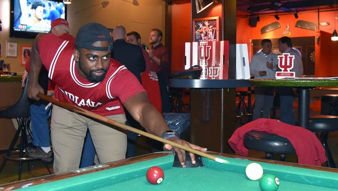 Richard Reese plays pool at the Rocket Bar in Washington on March 9, 2017.  He currently lives in Bowie, Md., but the Ft. Wayne, Ind., native is an Indiana University fan, and came to the bar to watch the Big Ten men's basketball tournament.