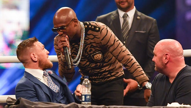 Floyd Mayweather shouts at Conor McGregor  during the press conference to promote the upcoming Mayweather vs McGregor boxing fight at SSE Arena.