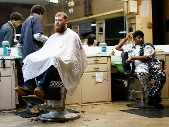 Karl Paige, 43, owns the only barbershop in Saluda,