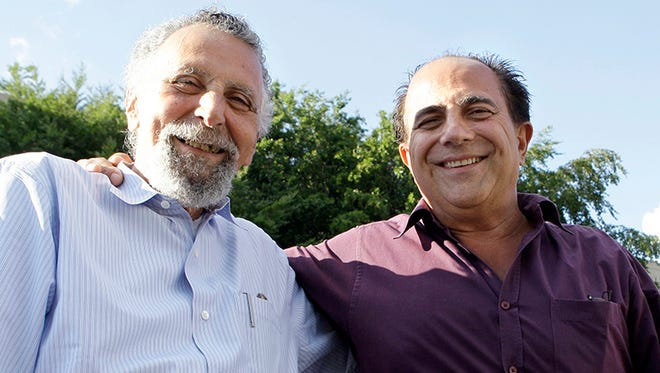 """Brothers Tom Magliozzi, left, and Ray Magliozzi, hosts of National Public Radio's """"Car Talk"""" show, pose together in Cambridge, Mass., on Thursday, June 19, 2008. (AP Photo/Charles Krupa)"""