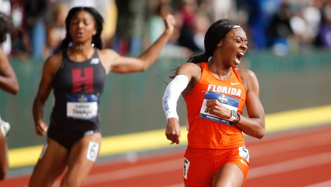 Florida's Kyra Jefferson, right, celebrates her victory in the women's 200 meters on the final day of the NCAA outdoor college track and field championships in Eugene, Ore., June 10, 2017.