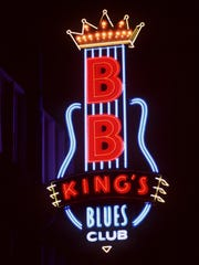 "May 3, 1991 - The neon sign for B.B. King's Blues Club on Beale Street opening night. King opened the premiere performance at his establishment with ""Somebody Changed the Locks on My Door."" (Steve Jones / The Commercial Appeal)"