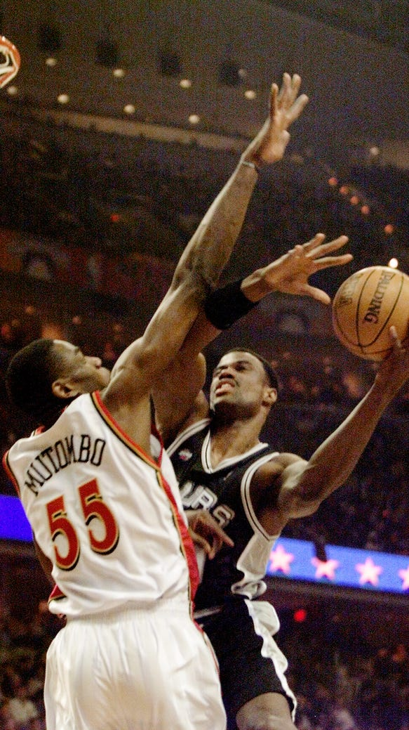 Mutombo was not easy to shoot around, as David Robinson