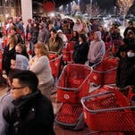 A crowd of shoppers wait outside the Target store in Lisbon, Conn., before the store opens for Black Friday shopping at midnight.