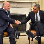 Iraqi Prime Minister Haider Al-Abadi is welcomed into the West Wing of the White House.