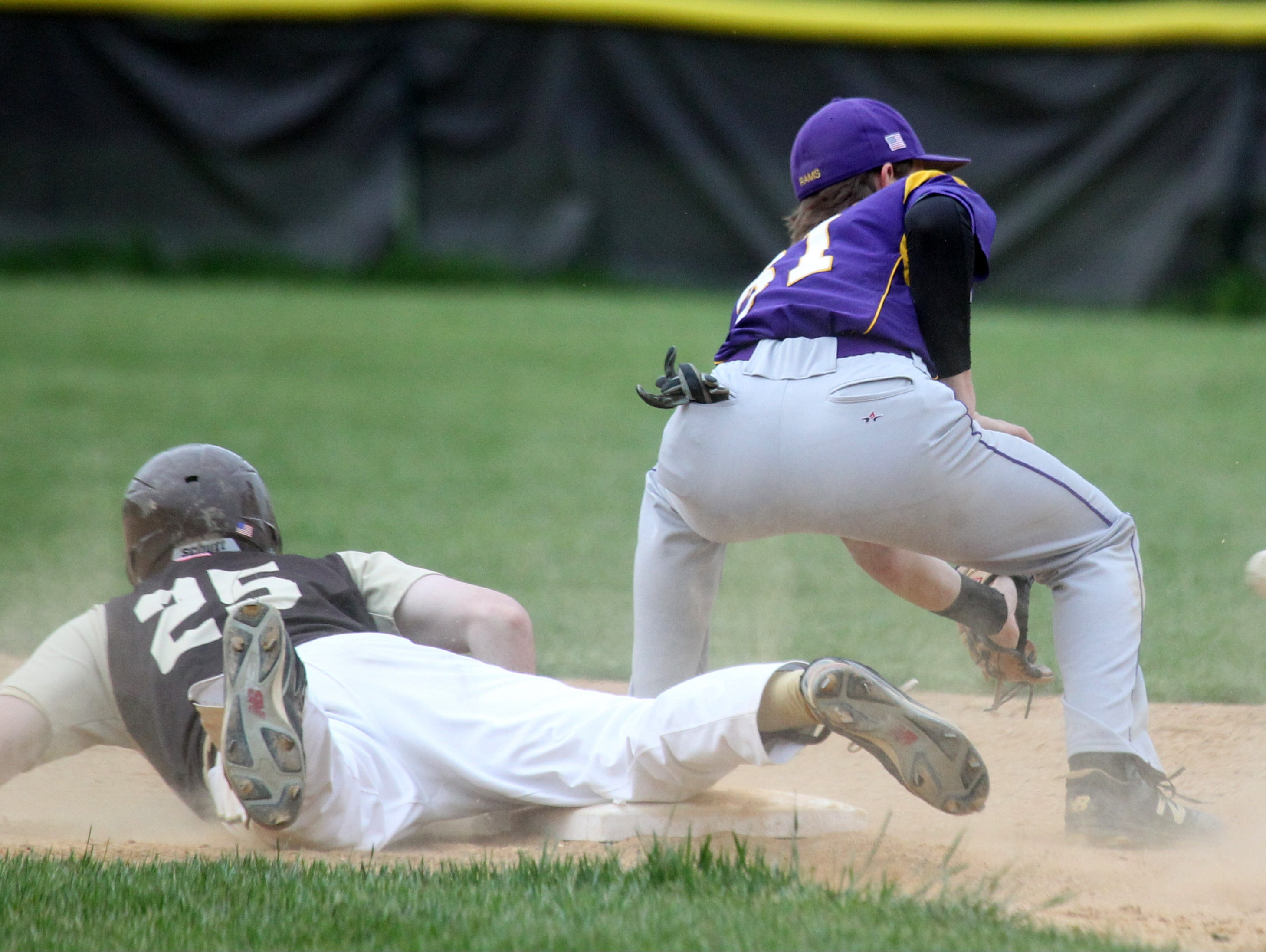 Clarkstown South's Tommy Doherty beats the tag of Clarkstown North's Brian Kay during their game at South May 10, 2016. South won 15-4.
