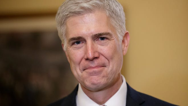 Supreme Court Justice nominee Neil Gorsuch meets with Senate Majority Leader Mitch McConnell of Ky. on Capitol Hill in Washington, Wednesday, Feb. 1, 2017. Last year, Senate Republicans, led by McConnell, blocked a confirmation hearing for Judge Merrick Garland, President Barack Obama's pick for the vacancy left by the death of Justice Antonin Scalia who died in February 2016. (AP Photo/J. Scott Applewhite)