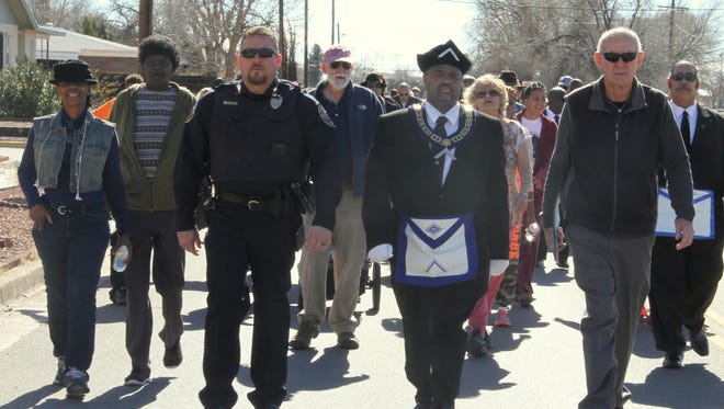 In this 2017 file photo, former Alamogordo Police Chief Daron Syling, Prince Hall Masonic Hall No. 11 member Everette Brown and Mayor Richard Boss walk along Washington Avenue during the Martin Luther King Jr. March.