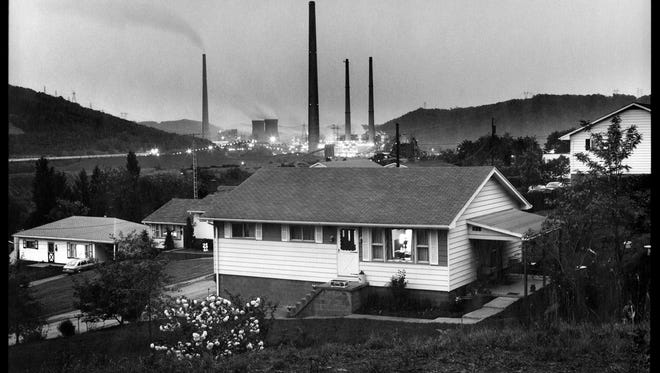"""Ted Wathen's photograph """"Home and Power Plant, Powhatan Point, Ohio""""  is part of the exhibit """"Coal – 1979"""" at University of Louisville's Photographic Archives Gallery."""
