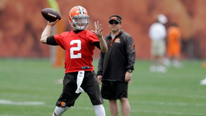 Cleveland Browns quarterback Johnny Manziel (2) passes at a mandatory minicamp practice at the NFL football team's facility in Berea, Ohio June 11, 2014.