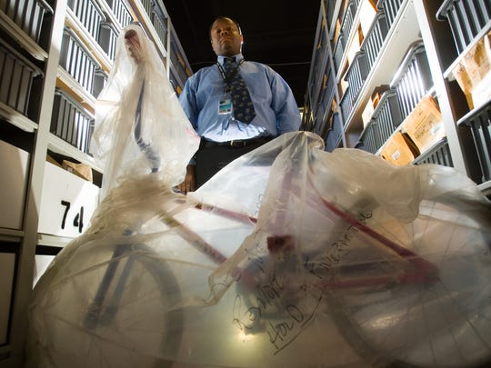 Mesa Detective Steve Barry stands with Mikelle Biggs' bicycle in the property room at the Mesa Police Department on Dec. 20, 2008. Barry was one of the many public-safety officers searching for Mikelle when she disappeared.