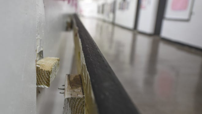 A separated handrail exposes bolts and screws at Simon Sanchez High School in Yigo on Oct. 1.