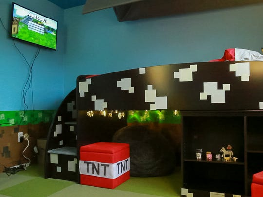 There is a cave under Colin Hayward Toland's bed in his Minecraft themed bedroom.