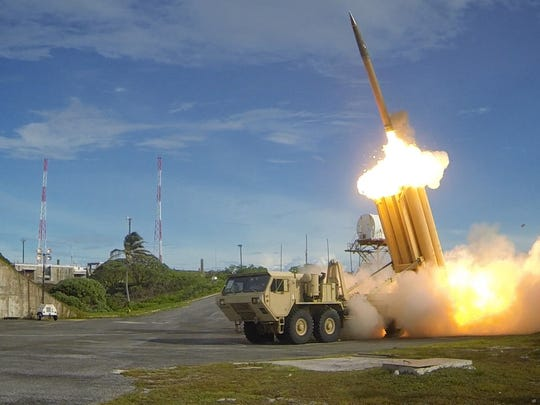 In this file photo, two THAAD interceptors and a Standard-Missile 3 Block IA missile were launched resulting in the intercept of two near-simultaneous medium-range ballistic missile targets during designated Flight Test Operational-01 on Sept. 10, 2013, in the vicinity of the U.S. Army Kwajalein Atoll/ Reagan Test Site and surrounding areas in the western Pacific.