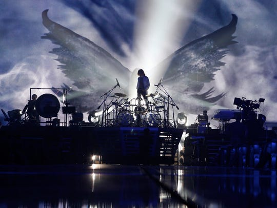 Yoshiki looks out over his drum kit during a rehearsal