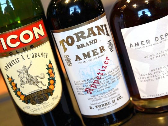 From Left, the main ingredient to a Picon punch includes the modern Amer Picon Club, Torani Amer or Amer Depot from three different brand companies.