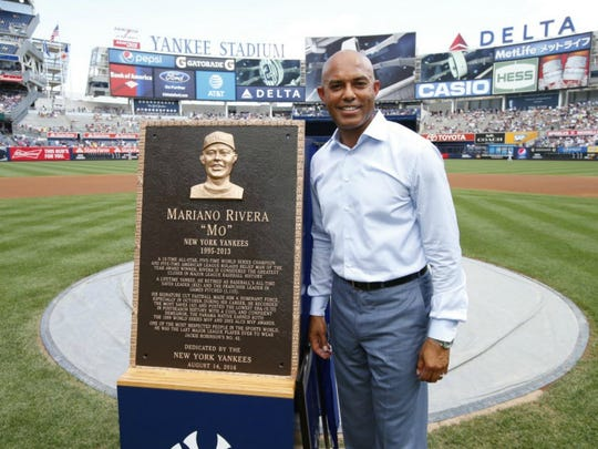 "Baseball's ""greatest closer"" Mariano Rivera poses with his Monument Park plaque."