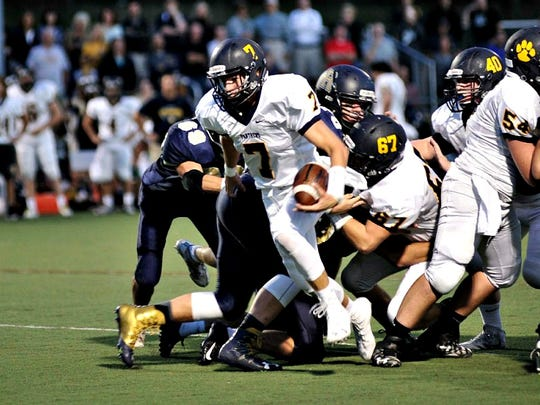 Pequannock's Dave Jachera (7) trying to break away from the pack during Friday's game.