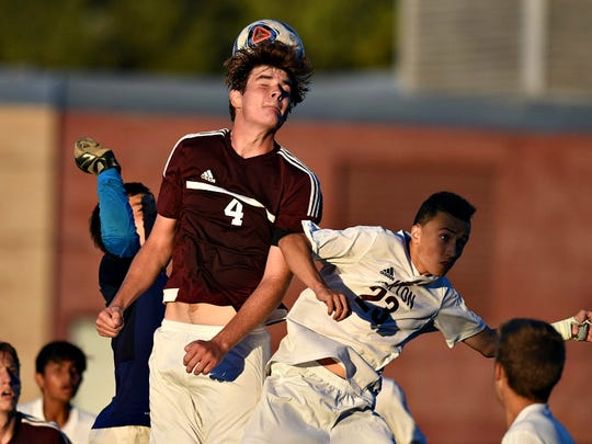 Jackson Szott of Wayne Hills, left, battling for possession with Kevin Salensky of Clifton.
