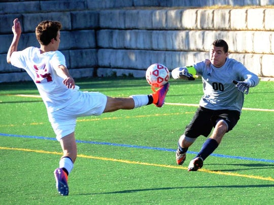 Junior Sal Vassallo beats the Saddle Brook keeper to record the game's first goal in the first half.