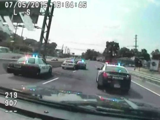 In this photo made from police dashcam video, the stolen Englewood Cliffs patrol car crashes into another police car that was trying to slow it down on Route 4 in Paramus on Sunday, July 6, 2015.