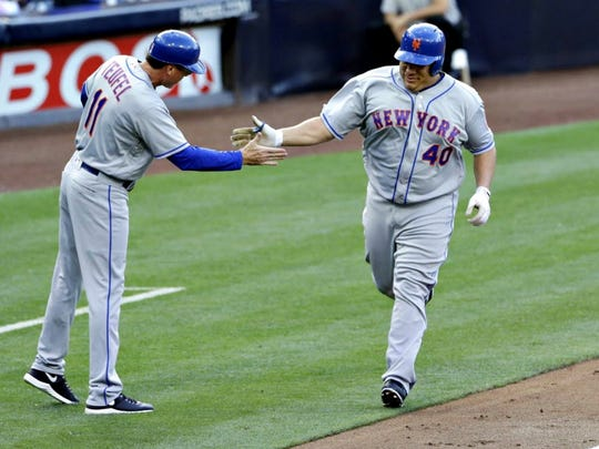 Mets' Bartolo Colon is greeted by third base coach Tim Teufel after hitting his first-career home run during the second inning against the San Diego Padres on Saturday, May 7, 2016.