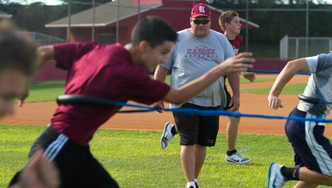 Riverdale baseball coach Bob Pringle works on speed drills with his players.