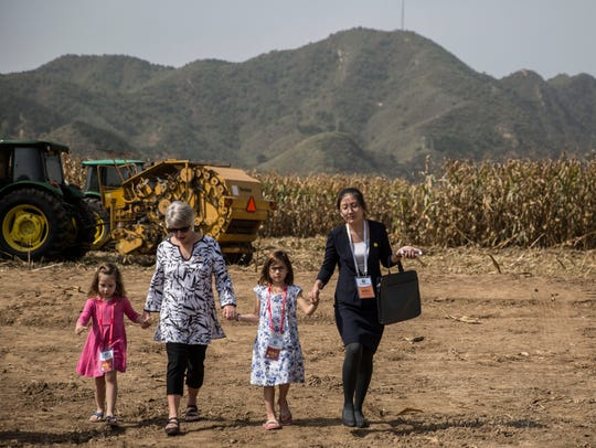 Chris Branstad, hand-in-hand with her granddaughters, Stella and Sofia Costa, leave a 2017 groundbreaking ceremony for the China-U.S. Demonstration Farm in Luanping County, Hebei, China.