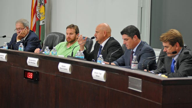 Members of the Brevard County state legislative delegation listen to constituent suggestions during a forum at the Brevard County Government Center in Viera. From left, Rep. Tom Goodson, Rep. John Tobia, Rep. Ritch Workman, House Speaker Steve Crisafulli and Sen. Thad Altman.