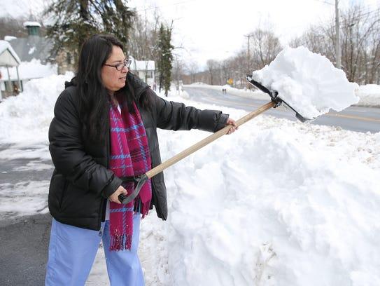Marilyn Johnston of Sloatsburg shovels car from her