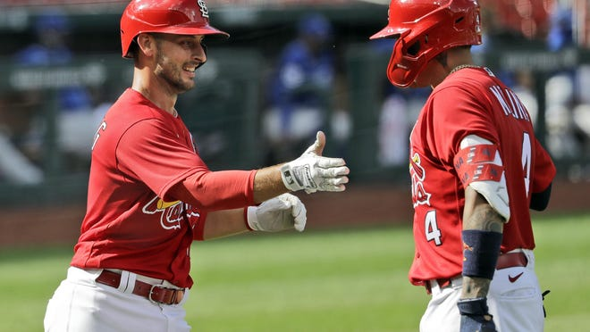 St. Louis Cardinals' Paul DeJong, left, is congratulated by teammate Yadier Molina after hitting a home run during an exhibition game against the Kansas City Royals on July 22 at Busch Stadium in St. Louis.