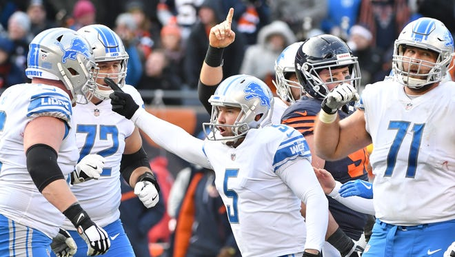 Kicker Matt Prater celebrates after his winning 52-yard field goal gave the Lions a 27-24 lead late in the fourth quarter.