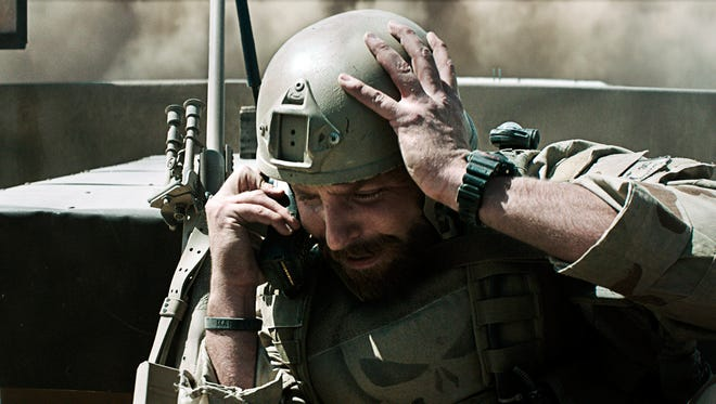"""This photo provided by courtesy of Warner Bros. Pictures shows Bradley Cooper as Chris Kyle in Warner Bros. Pictures' and Village Roadshow Pictures' drama """"American Sniper,"""" distributed worldwide by Warner Bros. Pictures and in select territories by Village Roadshow Pictures. (AP Photo/Warner Bros. Pictures)"""
