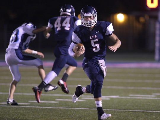 Lafayette Christian quarterback Regan Miller (5) scrambles