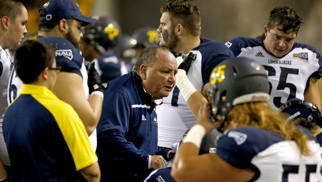 Northern Arizona University head coach Jerome Souers talks to his team during a football against Arizona State University at Sun Devil Stadium in Tempe on September 3, 2016.