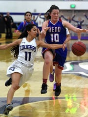 Spanish Springs' Naelia Pinedo knocks the ball away from Reno's Jill Rovetti as she was driving towards the basket during Tuesday's game at Spanish Springs.