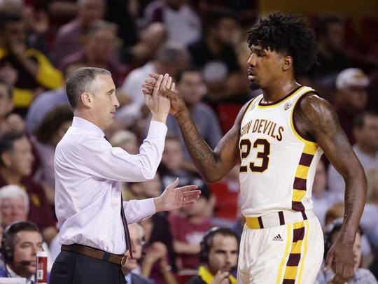 ASU coach Bobby Hurley high-fives forward Romello White