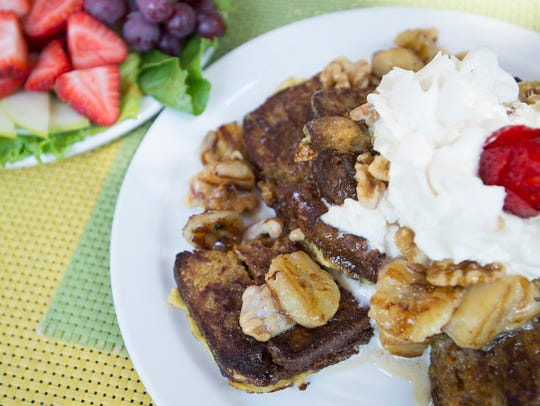 Banana rum French toast is served with walnuts and