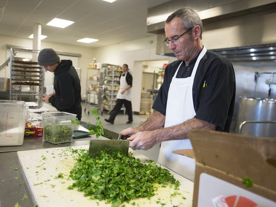Dave Nawrocki chops parsley that will make it's way