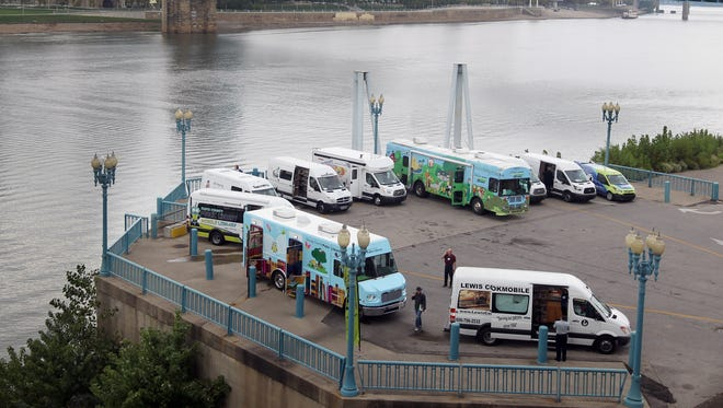 Ten bookmobiles are parked at Covington Landing as part of The Association of Bookmobile and Outreach Services (ABOS) conference which is being held at  the Cincinnati Marriott at RiverCenter in Covington. The bookmobiles are open to the public in the afternoon 10/20.  The Enquirer/Patrick Reddy