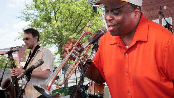Chris West, left, and Kevin Rimmer, members of the jazz band Halfbrass, put on a show for the throng gathered on the Square. Performers on stages positioned at opposite sides of the Square kept the entertainment non-stop.