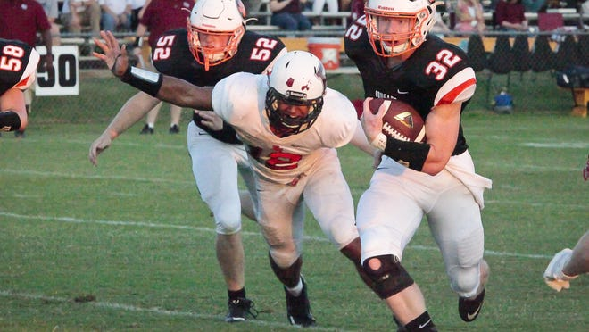 MTCS' Tanner Green (32) ran for 204 yards in the Cougars' 26-7 over Ezell-Harding on Friday night.