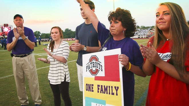 Melanie Loupe thanked the crowd for its support on Friday night during a pregame ceremony honoring her son Mason Loupe. The Siegel High School sophomore died Wednesday after suffering a gunshot wound.