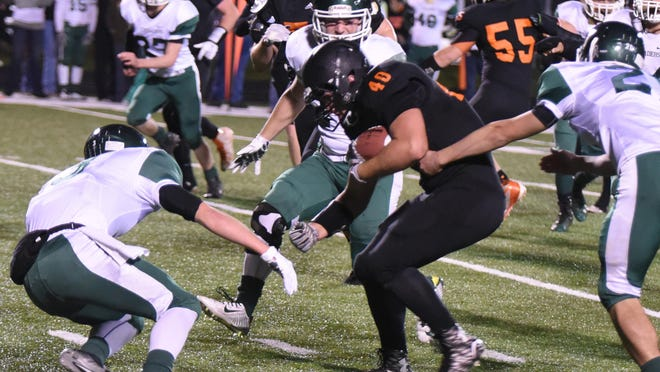 Logan Gray runs the ball for Scio against Salem Academy on Friday.