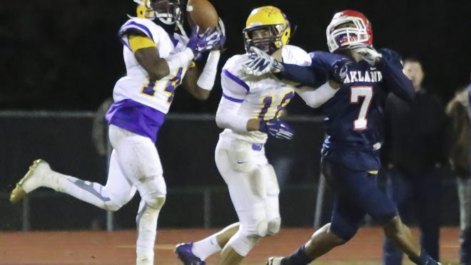 Smyrna cornerback Jordan Jone (14) is one of four in the secondary that the Bulldogs must replace.