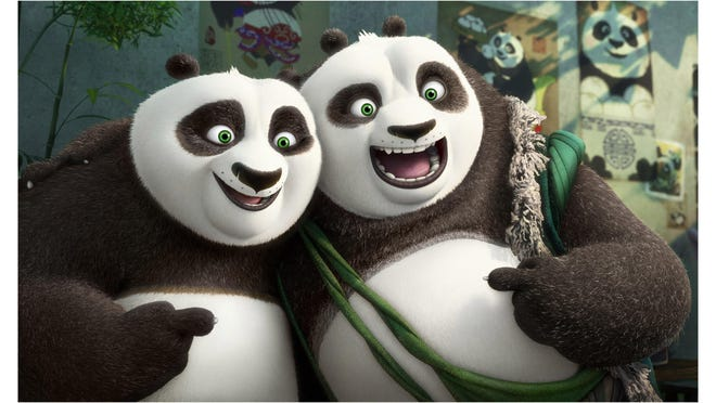 """(L-R) Po (voiced by Jack Black) and his long-lost panda father Li (voiced by Bryan Cranston) pose for a portrait in """"Kung Fu Panda 3."""""""