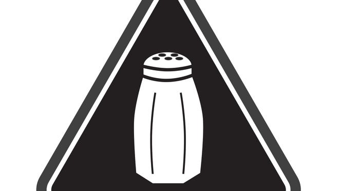 This graphic on menus warns New York consumers that a dish contains more salt, by itself, than doctors recommend that a person ingest in an entire day.