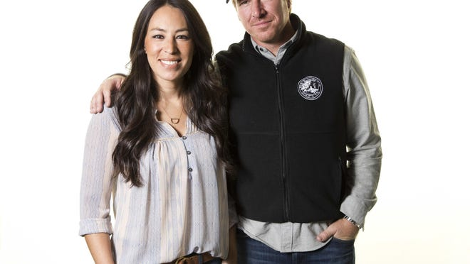 """FILE - In this March 29, 2016, file photo, Joanna Gaines, left, and Chip Gaines pose for a portrait in New York to promote their home improvement show, """"Fixer Upper,"""" on HGTV.  The series, which ran for five seasons before airing its final episode in April 2018, is coming back and will air exclusively on Magnolia Network when it launches in 2021."""